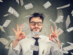 man enjoying money raining down